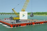 Liebherr HS 8300 duty cycle crawler crane in dredging application on a barge
