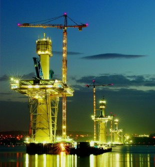 Cranes stand on special steel foundations and reach a total height of 235 m
