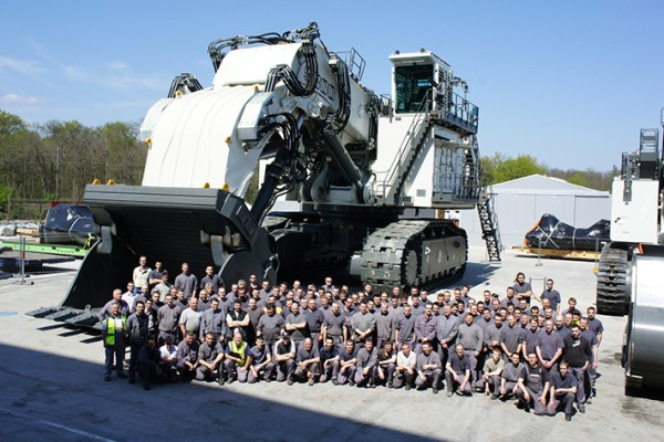 Members of staff in Colmar (France) in front of Liebherr's biggest mining excavator