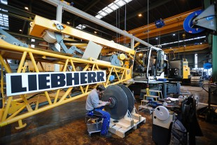 Workers in the assembly hall at Liebherr-Werk Nenzing GmbH