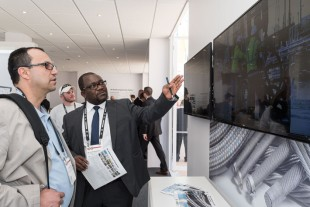 Visitors meet Dr. Ilaka Mupende in the Technology Pavilion