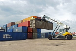 The Liebherr Reachstacker LRS 545 is busy handling containers at the Duisburg Intermodal Terminal.