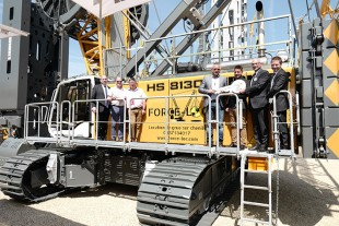 Handover of the HS 8130 HD to customer Force-Loc at the Intermat 2018.