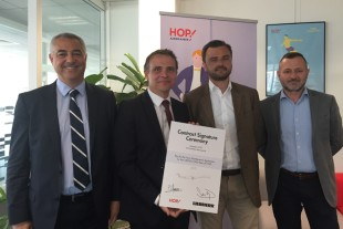 HOP!'s Pascal Lequemener, Chief Purchasing Officer (2nd from right), and Philippe Monnier, Maintenance Buyer Strategic Contracts (right), after the contract signature with representatives from Liebherr-Aerospace