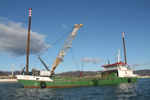 "The Liebherr duty cycle crawler crane in full operation of the barge ""Wise""."