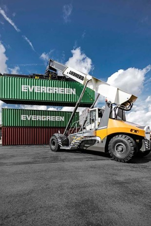 Liebherr Reachstacker LRS 545 hardworking handling container at Antwerp Port Belgium.