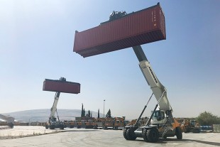 Two Liebherr reachstacker LRS 545 busy handling container at the premises of Somatel Liebherr.