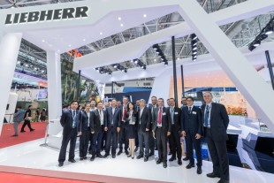 The NEIAS delegation headed by Jiao YuSong, President of NEIAS (8th from the right) at Liebherr's stand during Airshow China 2018
