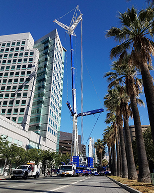 Bigge Crane and Rigging Co.'s LTM 1400-7.1 crane setting cooling towers atop a commercial building in downtown San Jose, CA.