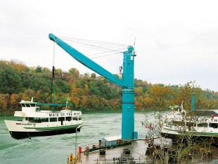 A Liebherr Fixed Cargo Crane (FCC) lifts passenger boats at the Niagara Falls.