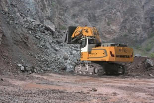 Liebherr crawler excavator R 970 SME with bottom-dump bucket configuration