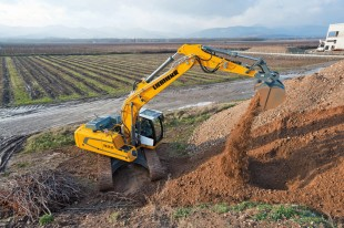 Liebherr R 922 crawler excavator in action carrying out excavation work in Alsace