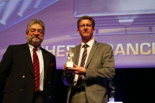 Laudator Michel Ducasse (Director Eurovia) and Thomas Haas (Managing Director of Liebherr -France SAS) with the Golden Trophy of the Intermat Innovation Prize in the