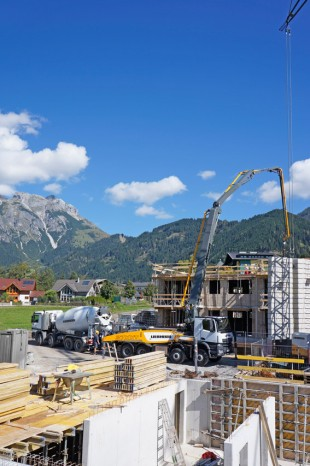 The Liebherr truck-mounted concrete pump 37 Z4 XXT during operation