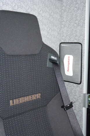 The Liebherr rescue sheet is located behind the driver's seat.