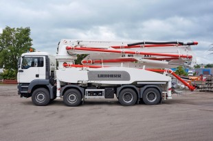 Liebherr truck-mounted concrete pump 41 M5 XXT with patented narrow support.