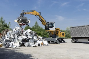 The Liebherr LH 22 M material handler loading a truck