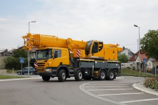 The Liebherr truck mounted telescopic crane LTF 1060-4.1 with full counterweight on the road