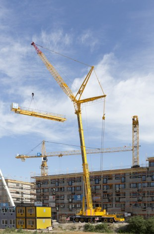 Liebherr LTM 1300-6.2 mobile crane erecting a tower crane