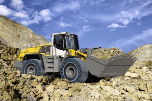 Equipment options such as specialist tyres with tyre protection chains, or special rock variant bucket set up Liebherr wheel loaders, such as the L 566, for tough operations in the quarry. A protective grill for the windscreen protects the driver from flying stones.