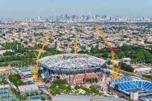 Buckner's Liebherr crawler cranes building the giant roof structure over the largest tennis stadium in the world.