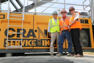 The management of Crane Service Inc. (from left to right: Robert Matz, Ken Ogle, Scott Wilson) in front of their new Liebherr crawler crane LR 1300 SX