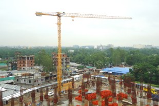 Liebherr tower crane helping to build an industrial building in Bangladesh.
