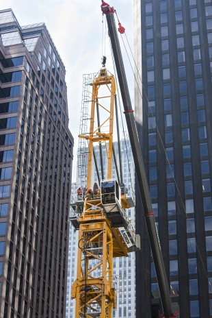 The Liebherr 710 HC-L luffing crane erection at MoMA Tower in New York City.