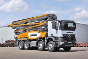 The Liebherr truck-mounted concrete pump 37 Z4 XXT in transport mode.