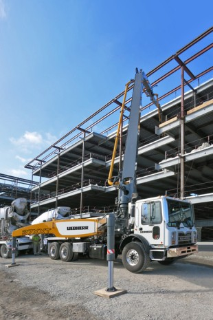 The Liebherr truck-mounted concrete pump 37 Z4 XXT on the job at a construction site in Santa Clara, CA.
