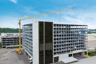 A Liebherr MK 140 mobile construction crane in action on a car park block