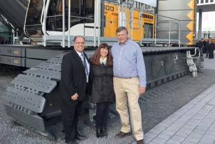 The owners of Ideal Crane Rental Inc. together with Liebherr's Ron Schad in front of an LR 1300SX crawler crane at Bauma.
