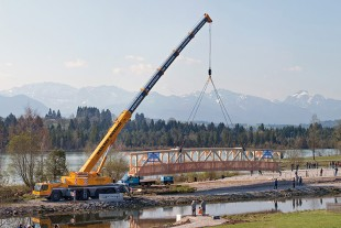 The Liebherr LTM 1200-5.1 all-terrain mobile crane shows its high versatility including a 72 m telescopic boom at a bridge construction site.