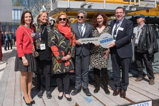 Liebherr hands over a symbolic key for several new LR 1500 cranes to Hovago at the Bauma.