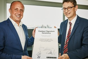 Mykhaylo Gvozdov, President of Antonov Company (left) and François Lehmann, Managing Director of Liebherr-Aerospace Toulouse SAS, at the contract signature ceremony at ILA Berlin Air Show 2016