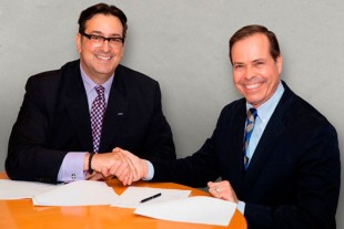 Orlando Camejo, Senior Vice President of Sales & Marketing, East Air and Alex Vlielander, President Liebherr-Aerospace Saline, Inc. at the contract signature