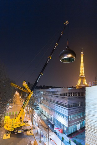 Trial hoist at night: The golden dome has a diameter of 12 metres and weighs eight tonnes.