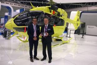 Jean-Luc Maigne (right), Managing Director Liebherr-Aerospace Toulouse SAS and Frédéric Carrière (left), In-service Program Manager Liebherr-Aerospace Toulouse SAS with the award at the Airbus Helicopters stand.