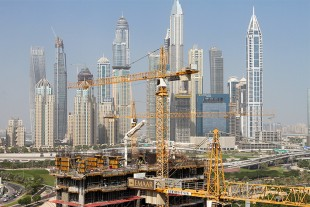 Seven 200 EC-H tower cranes in action building