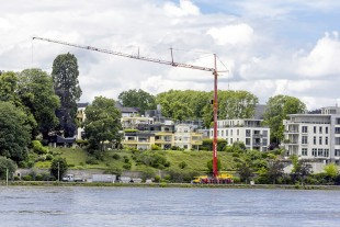 The Liebherr MK 140 Plus mobile construction crane operated by Salgert GmbH working in difficult conditions on the banks of the Rhine in Bonn.