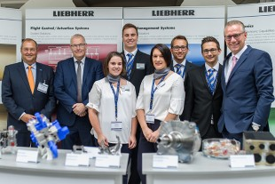 H. Lütjens, CTO, Liebherr-Aerospace & Transportation SAS and 2nd Vice President DGLR, (far right) welcomed Prof. Henke, DGLR President (2nd from left), and Dr. Ebenhoch, Head of Technology Management, MTU Aero Engines (far left), at the Liebherr booth.