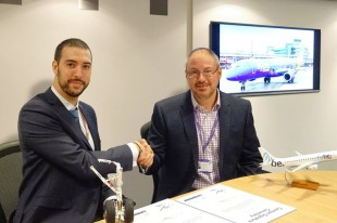 Luke Farajallah, COO & Accountable Manager at Flybe (on the right), and Pierre Herbillon, Regional Sales Manager at Liebherr-Aerospace Lindenberg GmbH at the contract signature ceremony. - © Liebherr