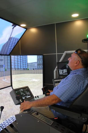 Frank Mkrdijian, MKR Equipment Services, Inc., in the LR 1300 crane simulator at the Lodi Opening reception