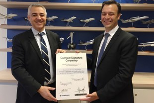 Eduardo Marchese Ribeiro, Contract Administration Manager, Embraer Netherlands BV, and on the left Thierry Gourmanel, Head of Sales & Marketing EUMA, Customer Services, Liebherr-Aerospace & Transportation SAS, at the contract signature ceremony.