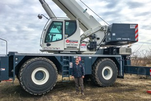 Joseph Mirabile, Mid Atlantic general manager for crane rental and rigging at M-L Holdings Co., UCR's parent company, with a Liebherr LRT 1100-2.1.