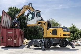 A Liebherr LH 22M material handler loading a container