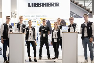 Marcel Steinhauser together with Liebherr trainees at the training and education stand at Bauma.