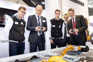 Michael Piazolo, Bavarian State Minister for Education and Culture, at the Liebherr training stand at Bauma.