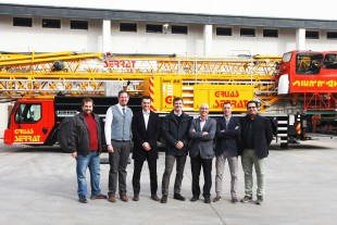 Josep Vega (3rd from right), owner of the Spanish crane company Grùas Serrat, takes delivery of the first MK 88 in Spain.