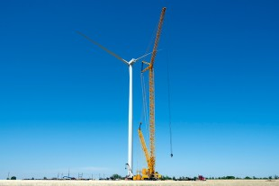 Crews install a blade socks on a wind turbine that has a hub height of nearly 400 feet.